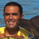 Nadar com golfinhos - Programa Nado Carona Golfinho - atividade beijo com golfinho.