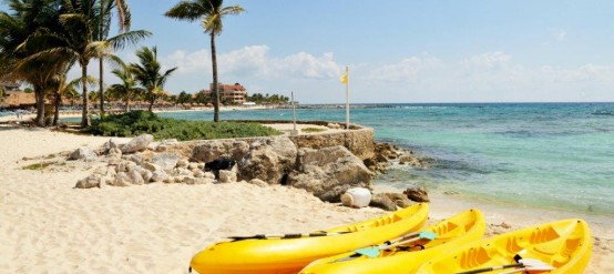 Kayaks laying on the Cozumel beaches, Riviera Maya.