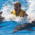 Swim with dolphins in Cancun.
