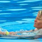 Nado con delfines - Programa Swim and Ride - belly ride.