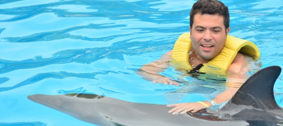 Interacting with dolphins in Dolphinaris' Dolphin Swim Speed Ride