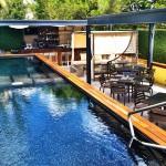 The Sundeck Lounge Dolphinaris Cozumel - Bar restaurant exterior next to pool.