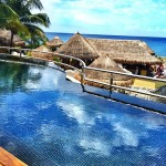 The Sundeck Lounge Dolphinaris Cozumel - Deck with infinity pool.