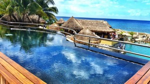 The Sundeck Lounge Dolphinaris Cozumel - Deck with infinity pool